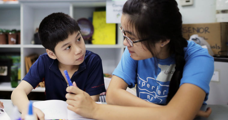 Amanda, 19, having a moment with Philemon, 10, from MINDS Lee Kong Chian Gardens School