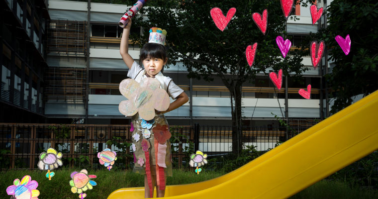 "Lorraine, a preschooler from AWWA Kindle Garden, poses as ""Florraine"", who turns things into flowers to make the world a beautiful place."