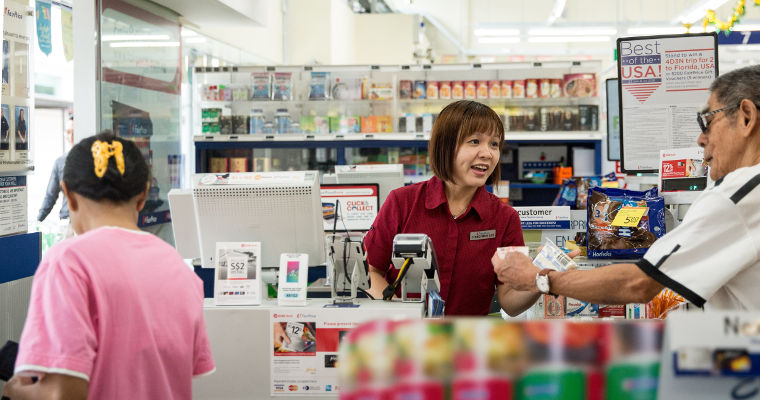 Photo of Meei Lee, 39, operating a cashier station at the supermarket.