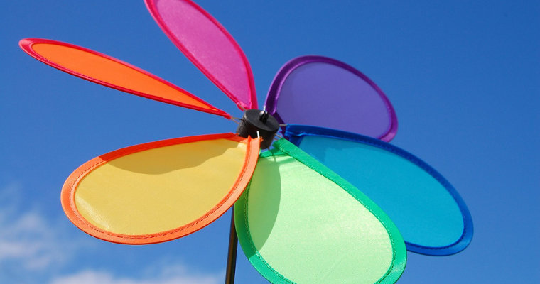Photo of pinwheel against blue sky