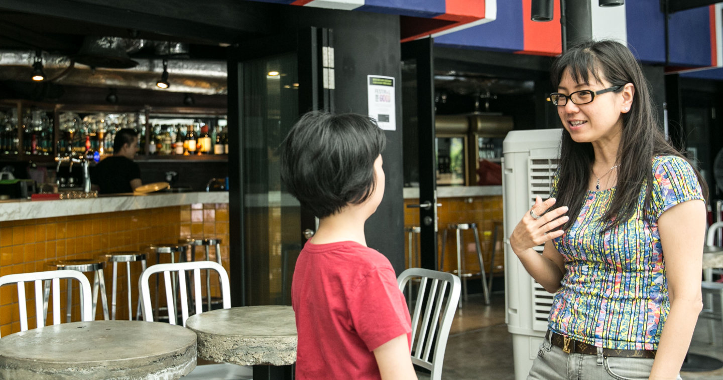 Photo of Josephine briefing one of the servers at the New Rasa Singapura restaurant