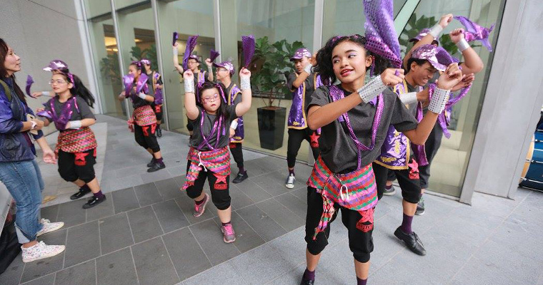Photo of a group rehearsing for the Purple Parade stage performance