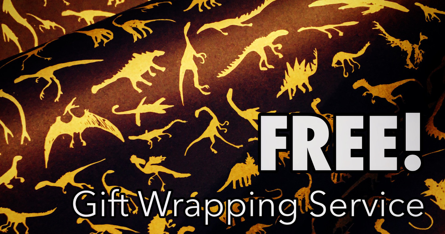 Close-up of dinosaur-design Christmas wrapping paper from The Art Faculty