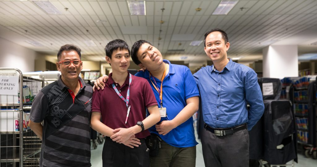 Group photo of staff at NUH's Medical Record Office: From left, Mr Rasid Bin Ekan, Ivan, Cheng Guang and Jimmy Yeap.