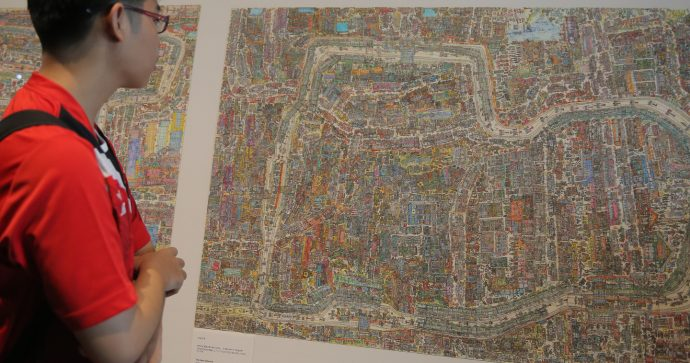 A visitor views an artwork by Norimitsu Kokubo
