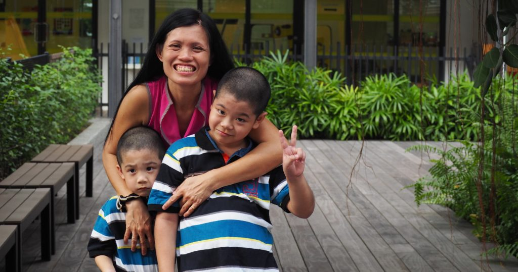 Photo of Madam Wong and her two sons