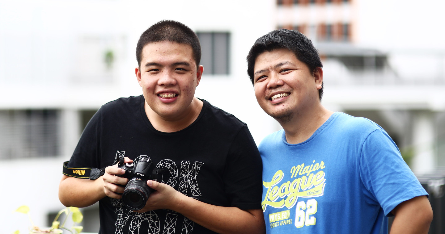 Photo of Bob Lee and Joshua Yeo, his photography student