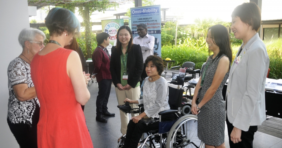 Photo of keynote speakers speaking with Ms Chia Yen Yen, President of SPD