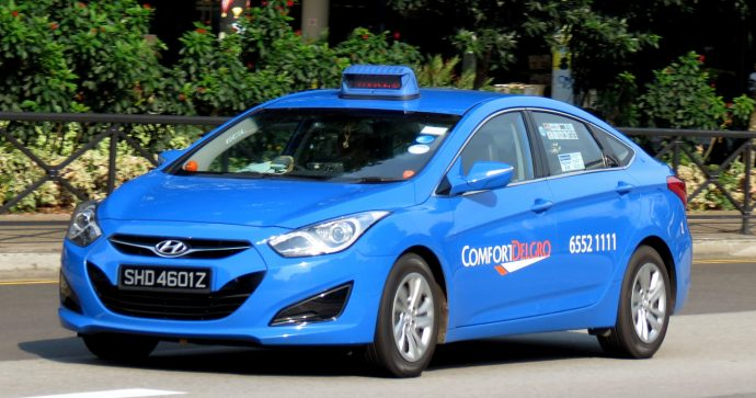 Photo of Comfort Delgro taxi on a Singapore road
