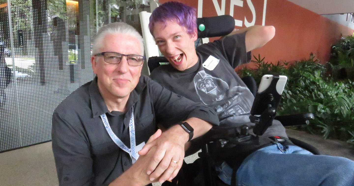 Photo of Garry and Christopher Hill at the Enabling Village