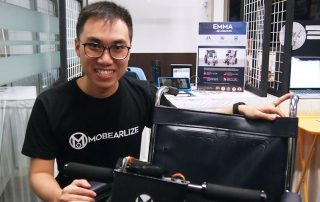 Photo of Mobearlize founder Chua Rui De posing with one of his mobility aids