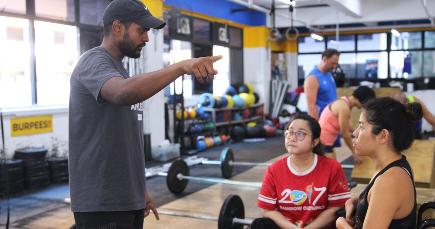 Photo of Moses James (left) with Paralympian Yin Pin Xiu (right)