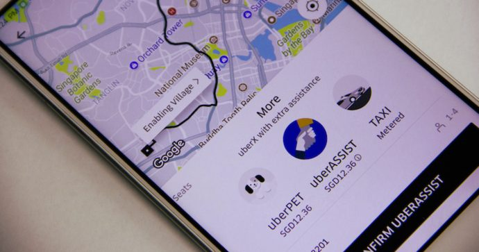 Photo of Uber app and uberASSIST service on a smartphone