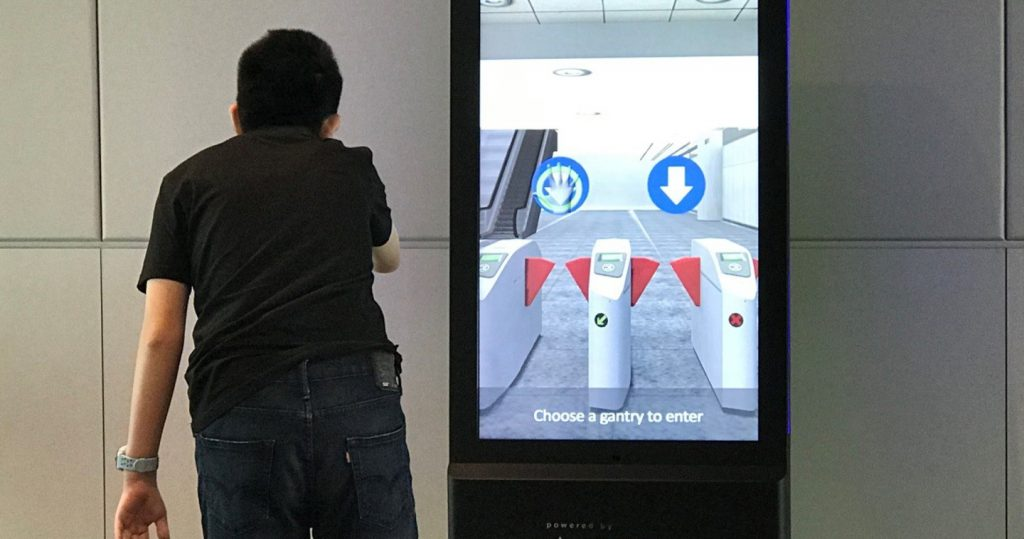 Photo of a person using an Interactive Mirror running a simulator for taking an MRT train