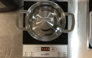 Photo of speaking stove, which reads temperature readings out loud so that blind users can prepare food independently.