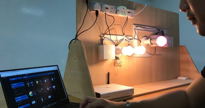 Photo of person setting up smart lights with a notebook computer