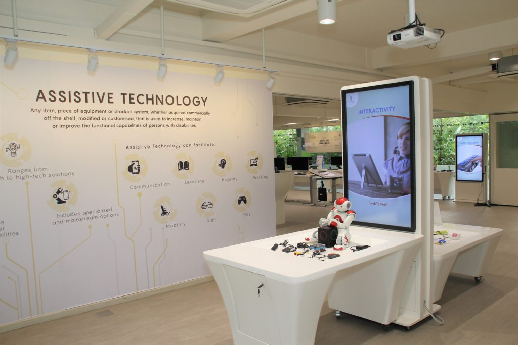 Interior of Tech Able showing digital screens and some assistive technology devices on display like [...] </p srcset=